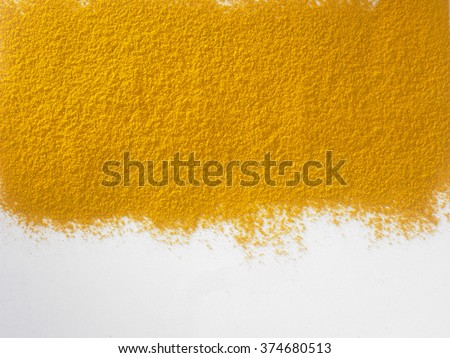 turmeric powder on the white background - stock photo