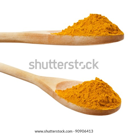 Turmeric powder spice on wooden spoon  isolated on white - stock photo