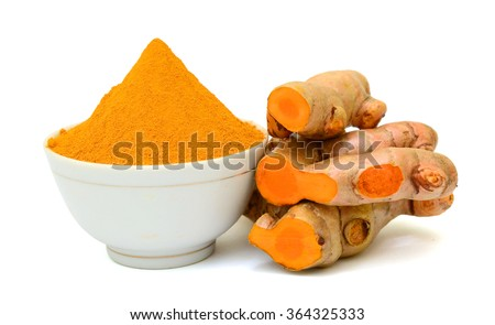 Turmeric roots with turmeric powder isolated on white background - stock photo