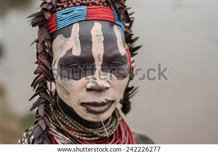 TURMI, Ethiopia, August 12: Unidentified Karo woman wearing natural ornaments in Turmi, Ethiopia, 12, August 2014. The ornament on her head are made by coleoptera wings - stock photo