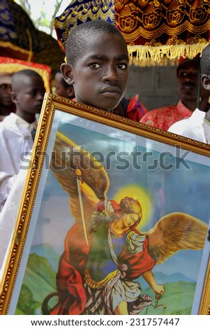 TURMI, ETHIOPIA - NOVEMBER 22, 2011: Portrait of the boy helping the priest in the Ethiopian orthodox church. November 22, 2011 in Turmi, Ethiopia. - stock photo