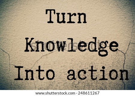 Turn Knowledge Into Action Concept write on wall  - stock photo
