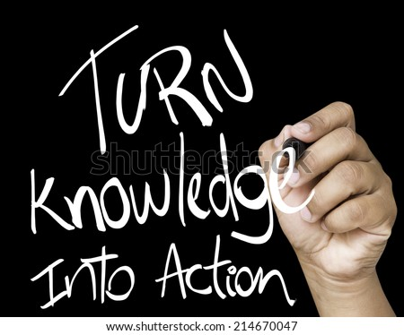 Turn Knowledge into action written on wipe board  - stock photo