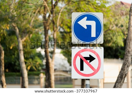 Turn left, and no right turn traffic sign post with clipping path - stock photo