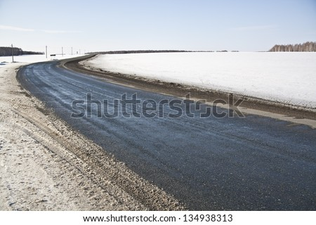 Turn of a winter road - stock photo