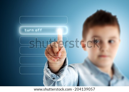 Turn Off. Boy pressing a virtual touch screen. Blue background. - stock photo