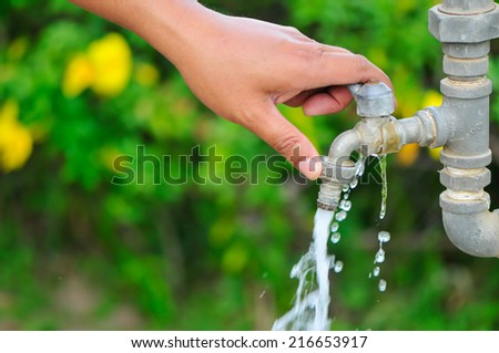 turn on faucet  - stock photo