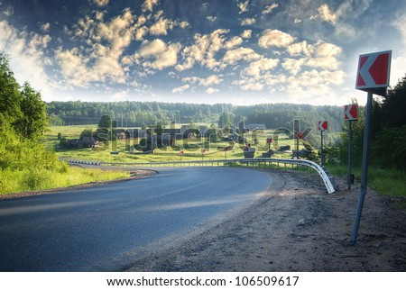 turn on the highway out of town and village on the nature - stock photo
