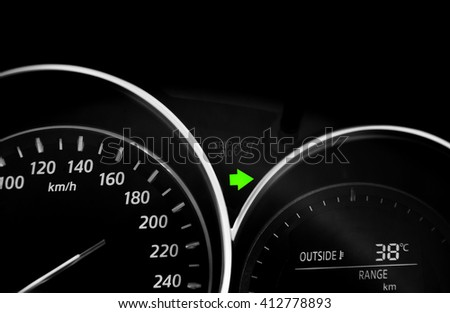 turn right arrow signal on the display in a car - stock photo