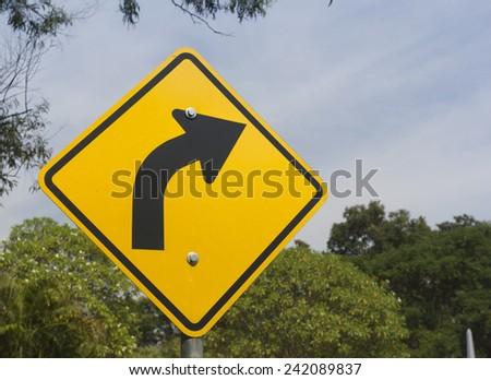 Turn right Traffic Sign in Garden - stock photo