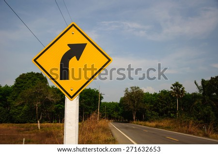 turn right yellow road sign - stock photo