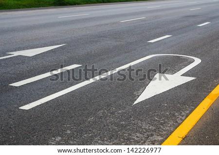 Turn Roadsign on roadground - stock photo