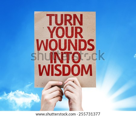 Turn Your Wounds Into Wisdom card with sky background - stock photo