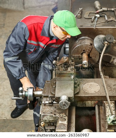 Turner is working on the machine.man  turner works for lathe  metal processing - stock photo
