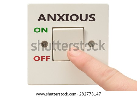 Turning off Anxious with finger on electrical switch - stock photo