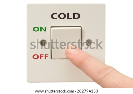 Turning off Cold with finger on electrical switch - stock photo