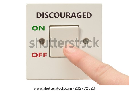 Turning off Discouraged with finger on electrical switch - stock photo