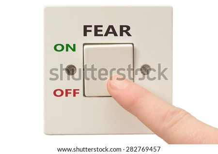 Turning off Fear with finger on electrical switch - stock photo