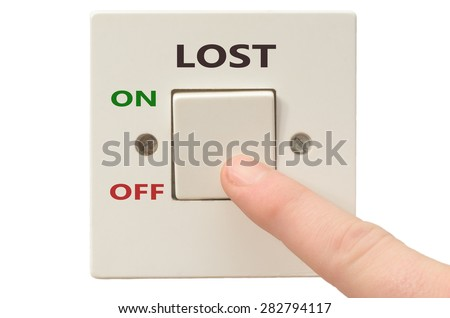 Turning off Lost with finger on electrical switch - stock photo