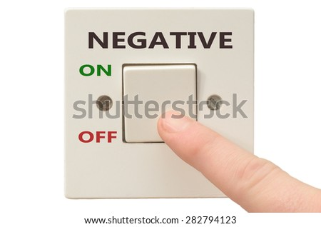 Turning off Negative with finger on electrical switch - stock photo