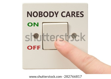 Turning off Nobody cares with finger on electrical switch - stock photo