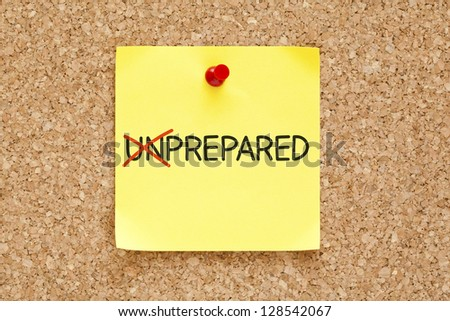 Turning the word Unprepared into Prepared with red marker on yellow sticky note pinned with red push pin. - stock photo