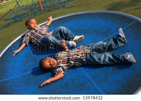Turning Twins - stock photo