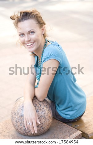 turning woman on bench in street - stock photo