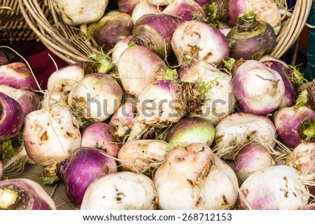 Turnips on display at the farmers market - stock photo