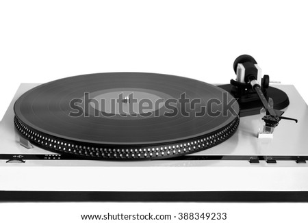 Turntable in gray case with black vinyl record with empty label on disc with stroboscope marks isolated on white background. Horizontal photo front view closeup - stock photo