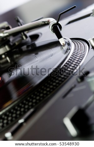 Turntable playing a record with music in the club - stock photo