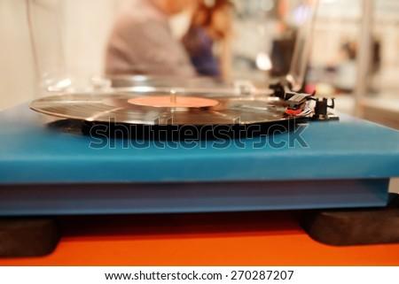 Turntable playing vinyl  - stock photo