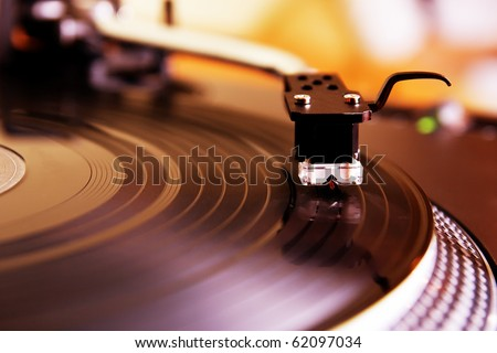 Turntable record player with vinyl disc. Close up on needle. Top level expensive audio equipment for DJ, also can be used as Hi-Fi for audio enthusiast. - stock photo