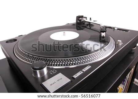 Turntable with needle on record, closed-up on black table - stock photo