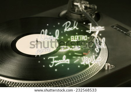 Turntable with vinyl and music genres writen concept on background - stock photo