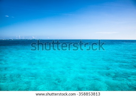 Turquise caribean color water near Isla Mujeres, Mexico. - stock photo