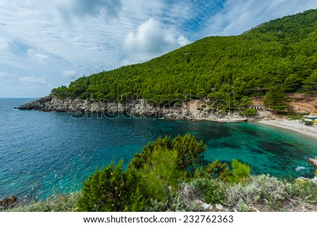 Turquoise bay with sandy beach and pines. Mljet Croatia. - stock photo