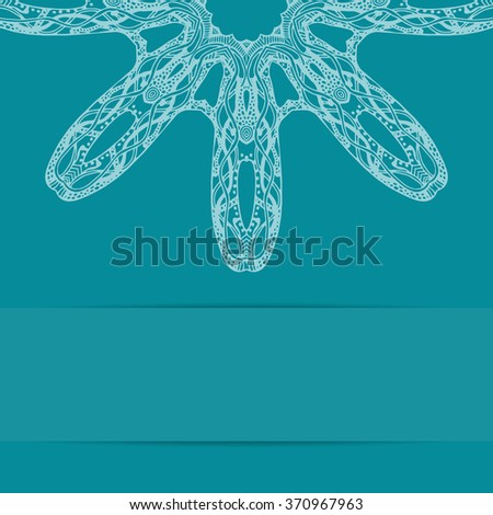 Turquoise blue card with floral zetagle ornate pattern and copy space below - stock photo