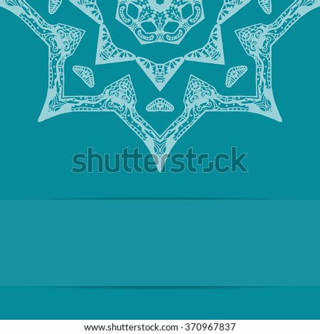 Turquoise blue card with ornate star pattern in zentangle style and copy space - stock photo