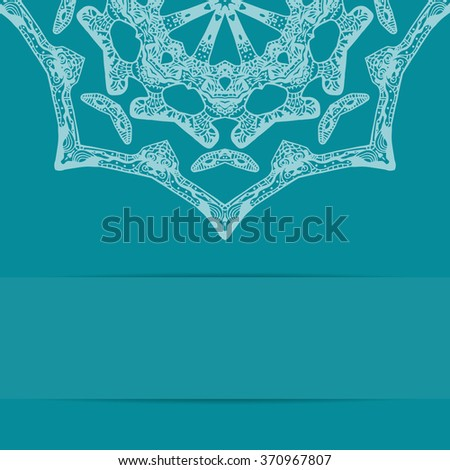 Turquoise blue card with unique ornate pattern and copy space. Zentangle and handdrawn style - stock photo