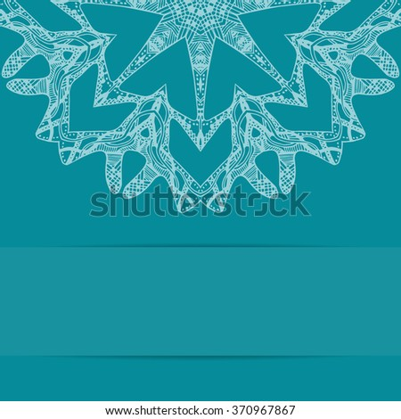 Turquoise blue card with zentangle round pattern and copy space below - stock photo