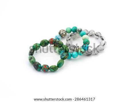 turquoise bracelet stone on white background - stock photo