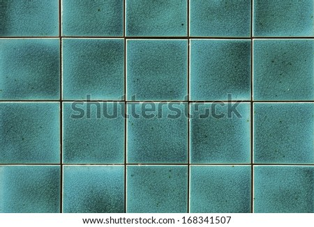 Turquoise ceramic wall tiles and details of surface - stock photo