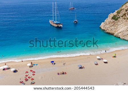 Turquoise Coast with Tourists and Yachts in Antalya, Turkey. - stock photo