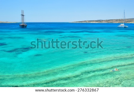 Turquoise crystal clear waters of paradise island Koufonisia, Small Cyclades archipelago, Greece - stock photo