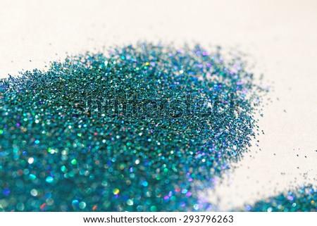 Turquoise glitter on light background - macro photo - stock photo