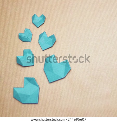 Turquoise love, 3d printed geometric heart's on brown, pack paper template - stock photo