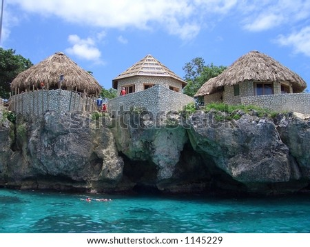 TURQUOISE OCEAN. Building houses on Negril Coast. - stock photo