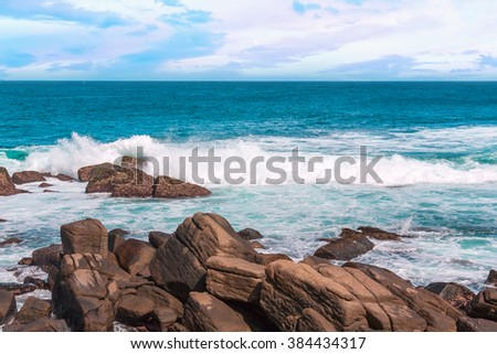 Turquoise ocean water ,blue sky and giant boulders on paradise beach. - stock photo
