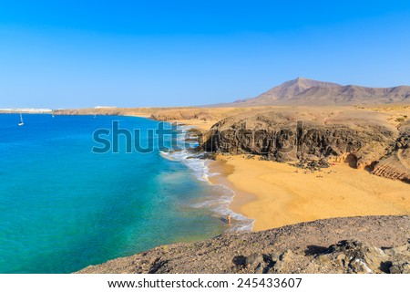 Turquoise ocean water on Papagayo beach, Lanzarote, Canary Islands, Spain - stock photo